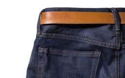 Джинсы джинсовой ткани с поясом на белизне изолировали предпосылку Стоковое фото RF