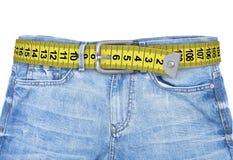 Джинсы с уменьшением пояса метра Стоковое Изображение RF