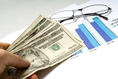Диаграмма и наличные деньги Стоковая Фотография