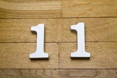 Диаграмма 11 на деревянном, пол партера Стоковые Изображения RF