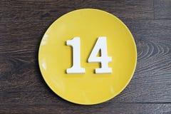 Диаграмма 14 на желтой плите Стоковая Фотография RF
