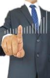 Диаграмма фондовой биржи на бизнесмене вытягивая или кладя голубую ручку стоковое изображение
