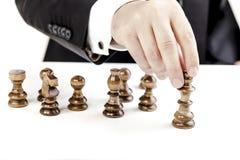 Диаграммы бизнесмена и шахмат Стоковое Фото