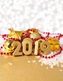 диаграммы 2019 год золотые на предпосылке decorati рождества Стоковые Фото