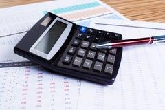 Диаграммы и калькулятор Стоковое Изображение