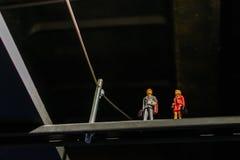 Диаграммы Leho мини над металлической стойкой Человек Lego в цене дела Стоковые Фото
