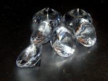 Диаманты на серебряной предпосылке Стоковая Фотография RF