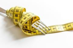 Диета концепции и потеря веса на белой предпосылке стоковое фото