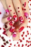 Дизайны ногтя с сердцами стоковые фотографии rf
