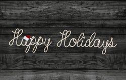 Дизайн веревочки приветствию праздника на черной древесине Стоковые Фото