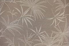 Дизайн листьев пальмы на tan предпосылке Стоковое Фото