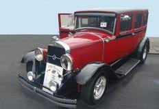 Диктатор 1928 Studebaker красного цвета стоковые фотографии rf