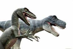 Динозавры на белой предпосылке стоковые изображения