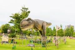Динозавр в парке Стоковая Фотография
