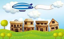 Дирижабль над районом с знаменем Стоковое Изображение