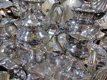 Диски и кувшины Silverware стоковое изображение