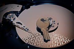 Диск жесткого диска компьютера и ключ безопасностью с влияниями Стоковая Фотография RF