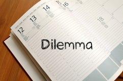Дилемма пишет на тетради Стоковое Изображение