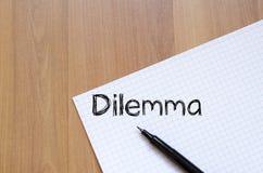 Дилемма пишет на тетради Стоковое Фото