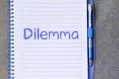 Дилемма пишет на тетради стоковое фото rf