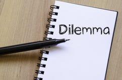 Дилемма пишет на тетради Стоковое Изображение RF