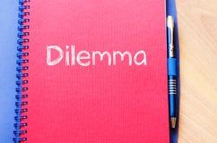 Дилемма пишет на тетради Стоковая Фотография RF