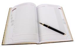 Дневник и ручка изолированные на белой предпосылке Стоковое Изображение