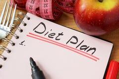 Дневник с рекордным планом диеты стоковое фото
