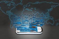 Телефон Mobil с предпосылкой атласа мира Стоковая Фотография