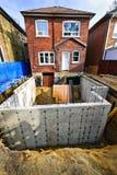 Добавление здания к дому стоковые фотографии rf