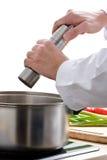 добавлять перец шеф-повара Стоковые Фотографии RF