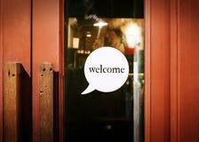 Добро пожаловать визирование на двери Стоковые Фото