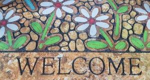 Добро пожаловать изолированный коврик у входной двери Стоковые Изображения RF
