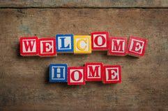 Добро пожаловать домашние блоки алфавита Стоковые Фото