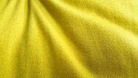 Довольно желтая предпосылка хлопко-бумажной ткани стоковое фото