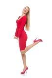 Довольно белокурая дама в красном платье изолированном на стоковые изображения