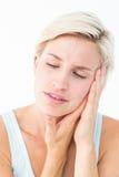 Довольно белокурый с болью зуба Стоковое Изображение