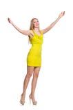 Довольно высокорослое изолированное платье желтого цвета женщины вкратце Стоковые Фотографии RF