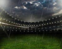 Дождь на футбольном стадионе стоковое изображение rf