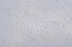 Дождевые капли на стеклянной предпосылке Стоковые Фотографии RF