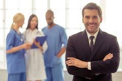 Доктора и бизнесмен Стоковая Фотография
