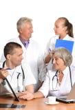 Доктора на таблице Стоковые Изображения
