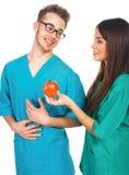 Доктора с яблоком Стоковые Фото