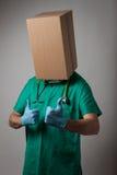 Доктор с головой картонной коробки Стоковые Изображения