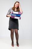 документирует офис девушки Стоковые Фотографии RF