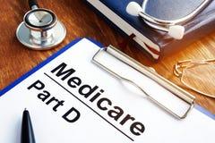 Документы части d Medicare с доской сзажимом для бумаги стоковая фотография rf