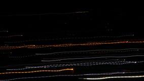 Долгая выдержка, света города запачкала движение, промежуток времени видеоматериал