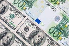 Долларовые банкноты американца 100 евро замечает отражение Стоковые Фотографии RF