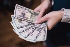 Долларовые банкноты, предпосылка денег Денег доллары конца комплекта вверх Стоковое Фото