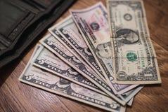 Долларовые банкноты, предпосылка денег Денег доллары конца комплекта вверх Стоковая Фотография RF